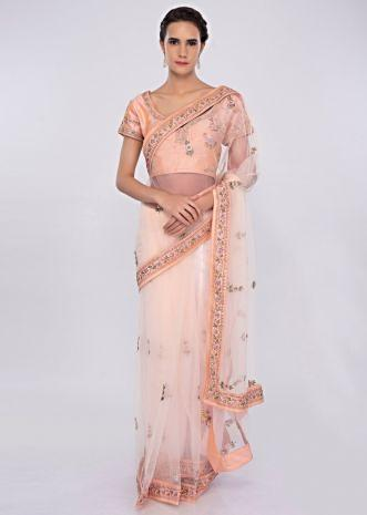 Creamish peach net saree with embroidered peach raw silk blouse only on kalki
