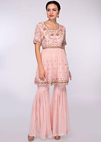 Crepe pink georgette sharara paired with matching embroidered suit