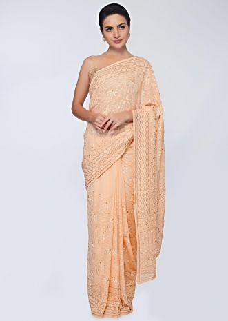 Dark cream georgette  saree featuring in floral embroidered jaal work