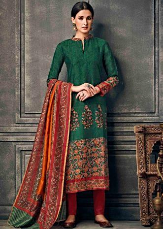 Dark green suit in silk with floral printed collar and hem line
