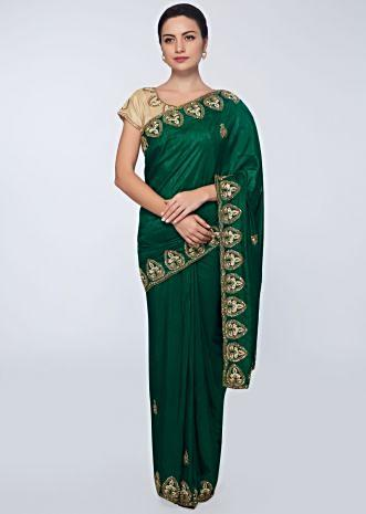 Emerald green  cotton silk saree in embroidered butti and border