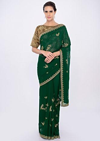 Emerald green georgette saree with embroidery and butti.  only on kalki