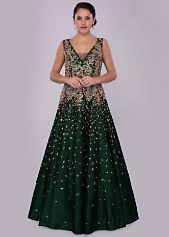 Emerald green raw silk gown with floral embroidered waist and bodice