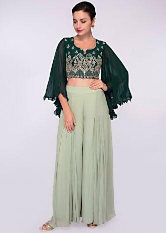 Emerald green silk suit in embroidery and butti paired with a flared