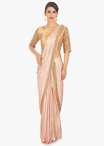 Fancy fabric peach blouse with lycra saree skirt in ready plated pre stitched pallo