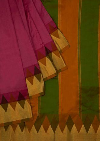 Featuring pink silk plain saree with green and mustard brocade pallo