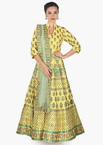 Featuring yellow anarkali in print and sequin motifs only on kalki