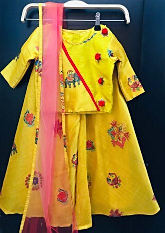 Featuring yellow crop top with palazzo and net dupatta