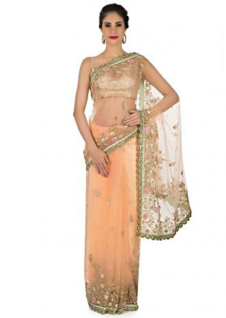 Featuring light peach saree in resham and gotta lace work only on Kalki