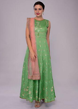 Fern green anarkali dress in multi color embroidery paired with pink net dupatta
