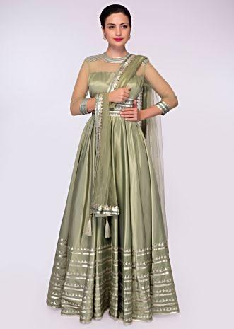 Fern green satin crepe anarkali gown with adorn with lurex stripes