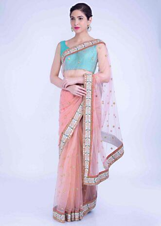 016257a835 Flamingo pink net saree with mint green raw silk blouse piece only on Kalki