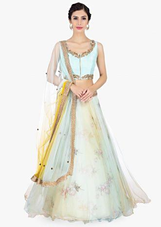 Floral printed organza lehenga with net top layer paired with a mint blouse and net dupatta