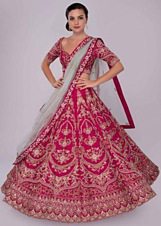 Fuchsia pink raw silk lehenga set in floral and temple embroidery