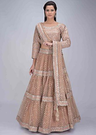 52c4ddd6dd Ginger beige net tiered lehenga set with matching raw silk blouse piece  only on Kalki ...