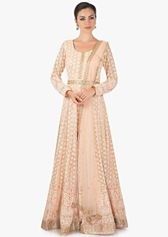 Gold peach  anarkali  with a pre attached  net dupatta  only on Kalki