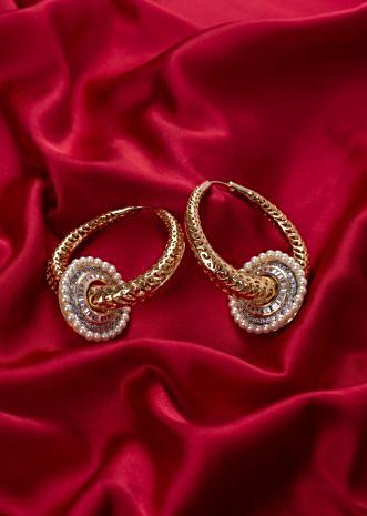 Gold plated metal hoop with cut outs only on Kalki