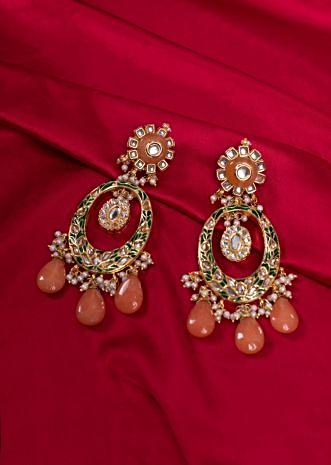 Gold plated traditional long chandelier earring with peach semi precious stone. only on kalki