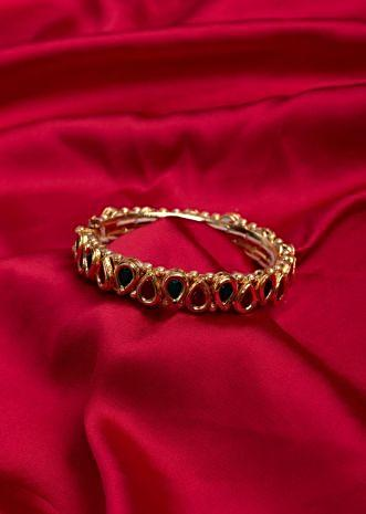 Gold plated traditional round kada in semi precious stone only on Kalki