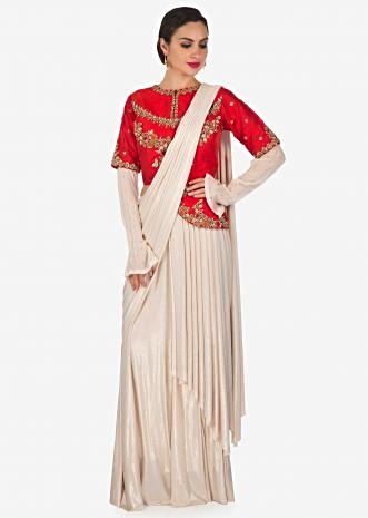 Gold lycra lehenga saree with pre stitched pallav and red raw silk embroidered blouse only on Kalki