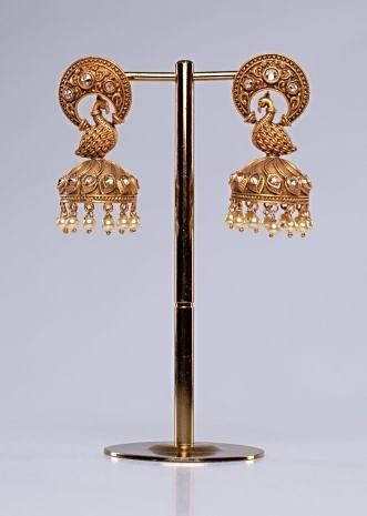Golden alloy temple earring with peacock motif