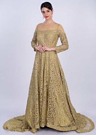 Golden beige sequins embroidered net gown with trail at the back only on Kalki