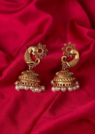 Golden temple jhumkas with peacock motif only on Kalki