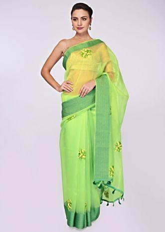 Green organza saree in resham and french knot embroidered butti