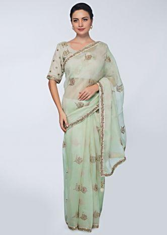 Green organza saree with embroidered butti and border