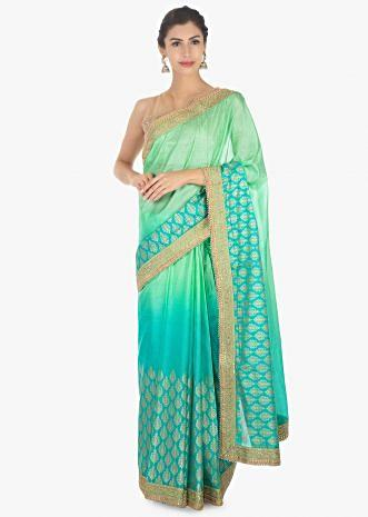 Green shaded  kotta silk saree with weaved hemline