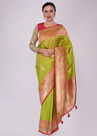 Green silk saree with weaved butti and brocade border