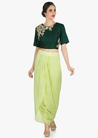 Green dhoti suit in raw silk is embellished with french knot in floral motifs only on Kalki