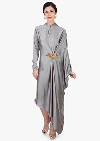 Grey asymmetric tunic with patch work on the waist along with pleats