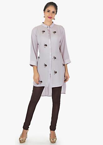 Grey georgette kurti with front short and back long enhanced with tassel motifs only on kalki