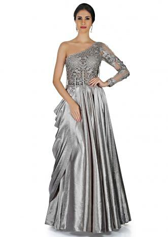 Grey gown adorn in tasseled bodice and cowl drape only on Kalki