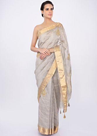 Grey linen checks saree with embroidered butti only on kalki
