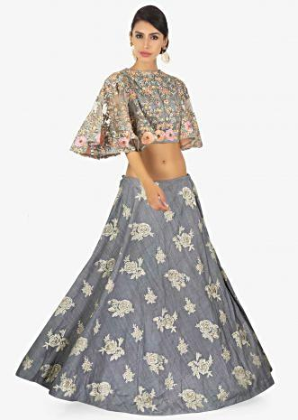 Grey net blouse with fancy cape sleeves paired with resham embroidered skirt