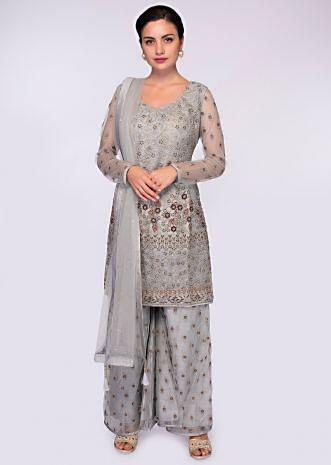 Grey net suit in embroidered jaal work paired with raw silk palazzo with net top layer