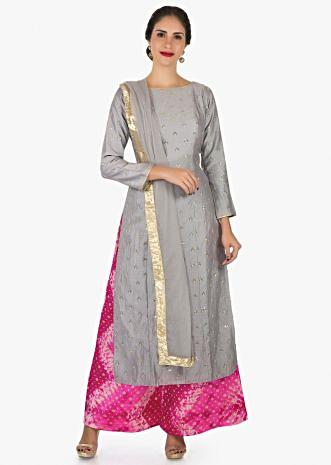 Grey and rani pink palazzo suit beautified with sequin zari butti embroidery work only on Kalki