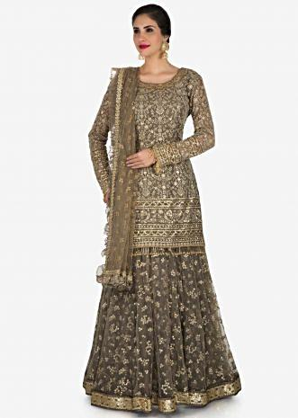 Grey skirt suit in silk heavily embellished in resham and sequin embroiderery work only on Kalki