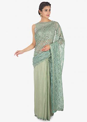 Half and half fern green lace and foil georgette saree in kundan
