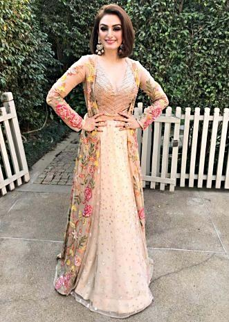 Akriti Kakkar in Kalki cream lehenga with organza floral embroidered jacket