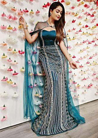 Teal green strapless fish cut gown with long net cape