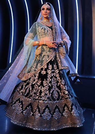 Peacock green velvet lehenga set paired with a mint green net dupatta