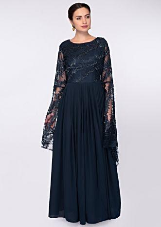 Indigo blue georgette gown with net embroidered bodice and fancy flared sleeves