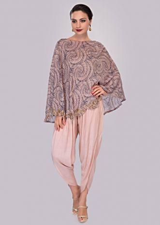Ivory dhoti pant paired with cape top in print and scallop border