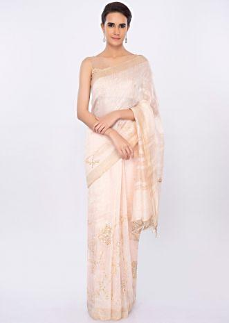 Ivory linen saree in floral jaal embroidery only on kalki