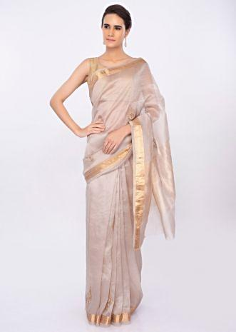 Ivory organza saree with butti work  only on kalki