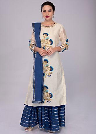 vory white suit with center embroidered butti with cobalt blue sharara and dupatta