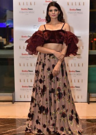 Ihana Dhillon in Kalki maroon ruffled bustier teamed with tan brown floral printed skirt